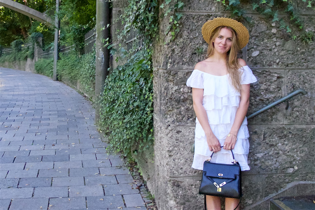 Summer Contrast. Fashion Blogger Girl by Style Blog Heartfelt Hunt. Girl with blond hair wearing a white off-shoulder dress, straw hat, vintage MCM bag and Birkenstock sandals.
