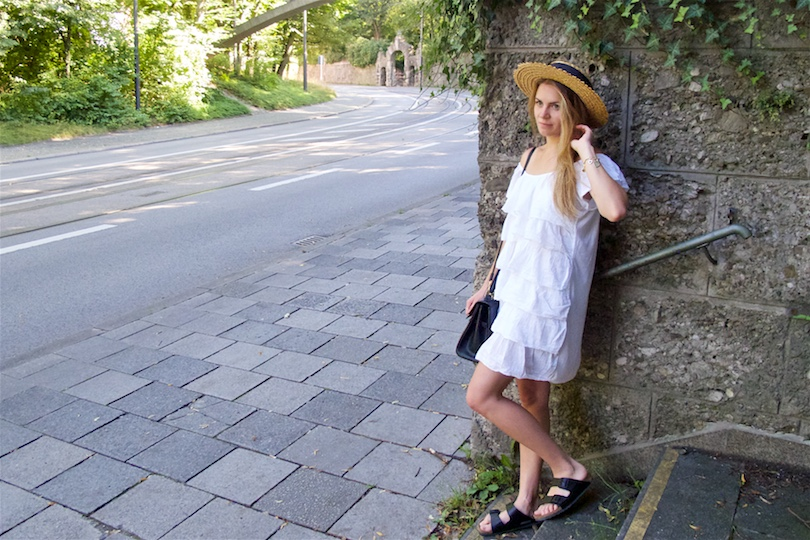 Summer Contrast. Fashion and Style Blog Girl from Heartfelt Hunt. Girl with blonde hair wearing a white off-shoulder dress, straw hat, vintage MCM bag and Birkenstock sandals.