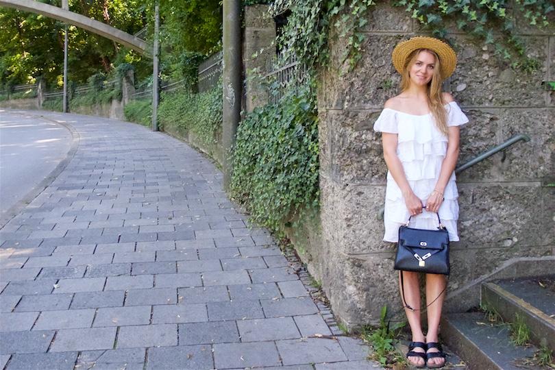 Summer Contrast. Fashion Blogger Girl by Style Blog Heartfelt Hunt. Girl with blond hair wearing a white off-shoulder dress, straw hat, vintage MCM bag and Birkenstock sandals.
