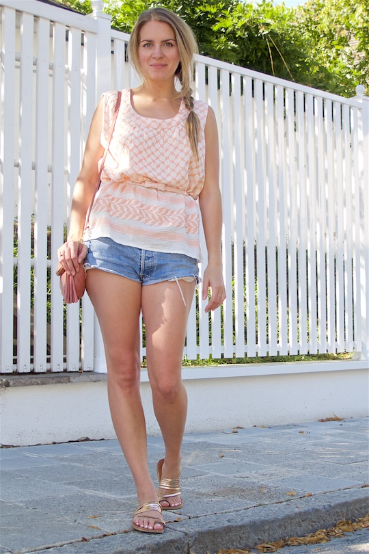Summer Pink. Fashion and Style Blog Girl from Heartfelt Hunt. Girl with blonde side braid wearing a summer pink top, denim shorts, pink bow belt, pink suede bag and metallic sandals.