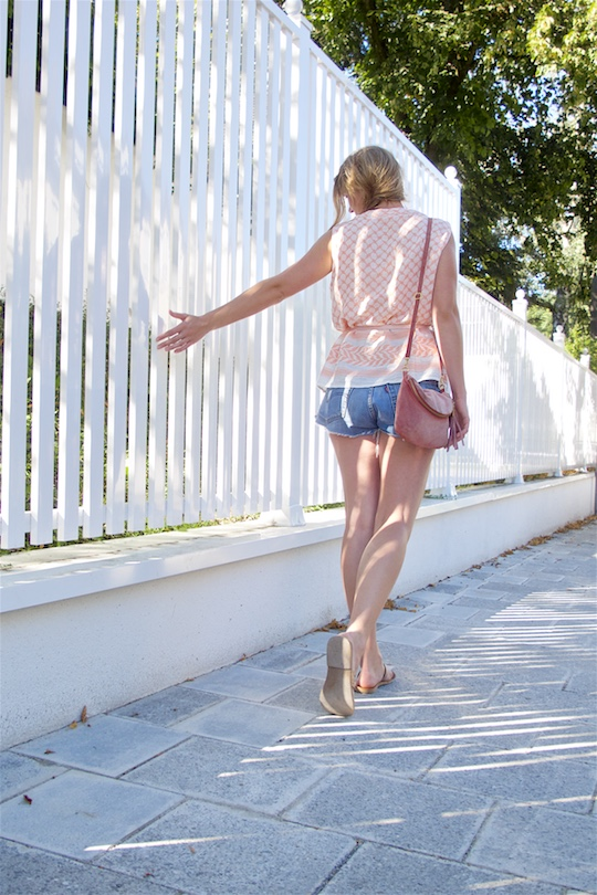 Summer Pink. Fashion Blogger Girl by Style Blog Heartfelt Hunt. Girl with blond side braid wearing a summer pink top, denim shorts, pink bow belt, pink suede bag and metallic sandals.