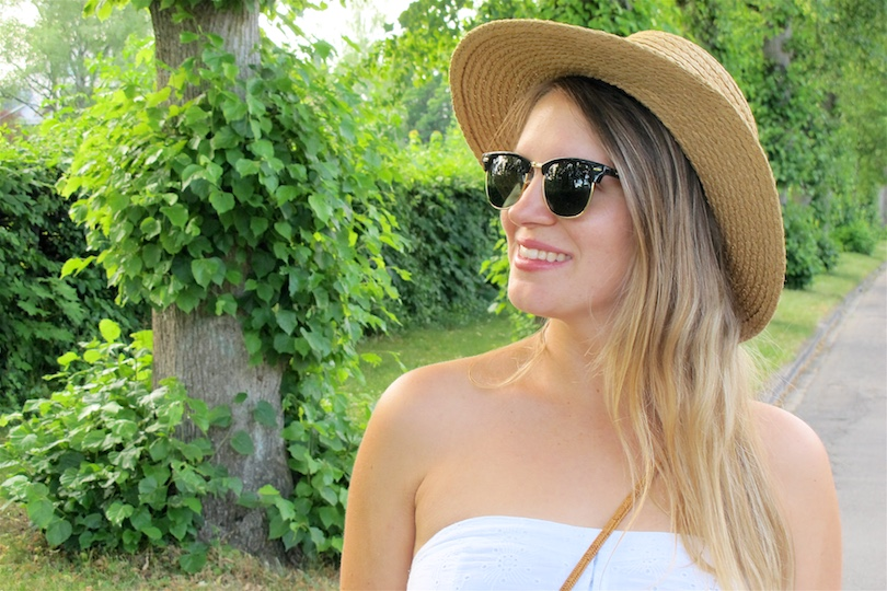 Summer White Straw. Fashion Blogger Girl by Style Blog Heartfelt Hunt. Girl with blond, long hair wearing a summer white dress, straw hat, Ray-Ban sunglasses, basket bag, denim shorts, espadrille sandals.