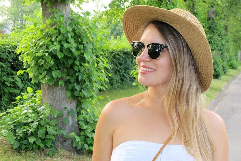 Summer White Straw. Fashion Blogger Girl by Style Blog Heartfelt Hunt. Girl with blond, long hair wearing a summer white dress, straw hat, Ray-Ban sunglasses, basket bag, denim shorts, espadrille sandals.