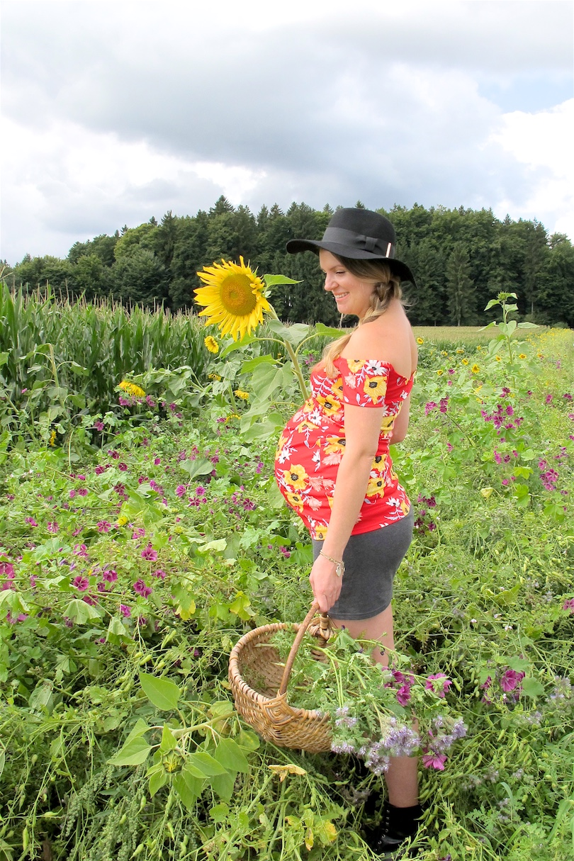 Sunflower Fields. Fashion and Style Blog Girl from Heartfelt Hunt. Girl with blonde side braid wearing a floral off-shoulder dress, skirt, floppy hat and boots.