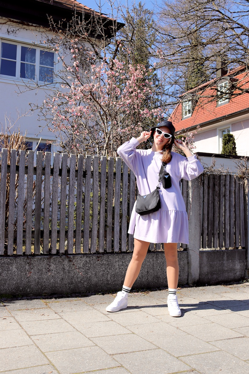 Sweatshirt Dress. Fashion and Style Blog Girl from Heartfelt Hunt. Girl with blonde hair wearing a sweatshirt dress, bucket hat, 90s bag, white socks and white sneakers.