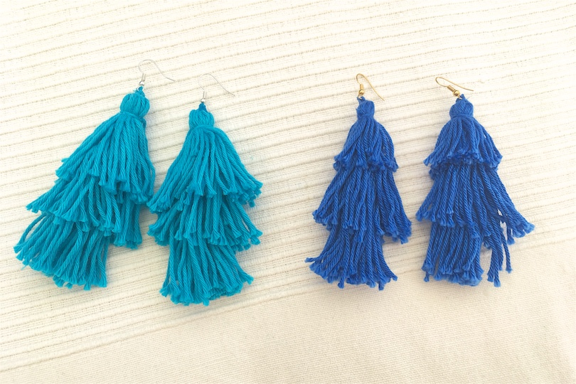 Tassel Earrings DIY. Fashion and Style Blog Girl from Heartfelt Hunt. Girl with blonde, long hair wearing a backless tassel top, basket bag with tassels, round sunglasses, denim shorts and sandals.