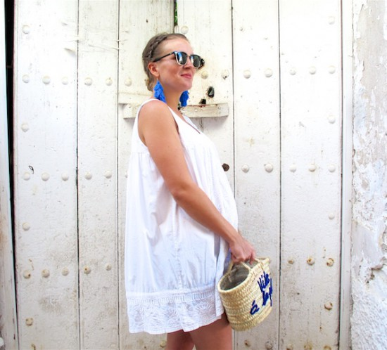 Tassel Earrings. Fashion Blogger Girl by Style Blog Heartfelt Hunt. Girl with blond dutch braided low bun wearing tassel earrings, white summer dress, Ray-Ban sunglasses, basket bag and espadrille sandals.
