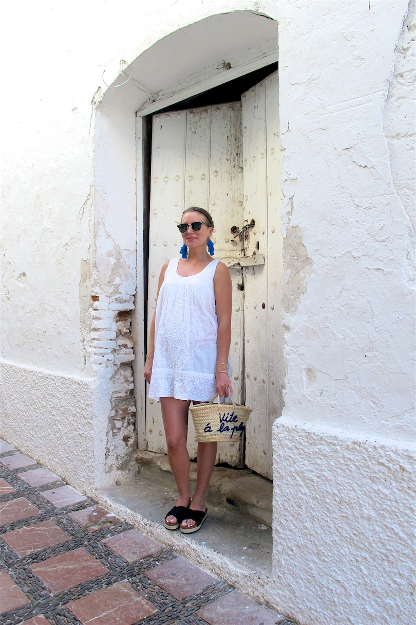 Tassel Earrings. Fashion Blogger Girl by Style Blog Heartfelt Hunt. Girl with blond dutch braided low bun wearing tassel earrings, white summer dress, Ray-Ban sunglasses, basket bag and espadrille sandals.