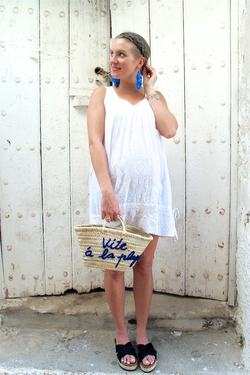 Tassel Earrings. Fashion and Style Blog Girl from Heartfelt Hunt. Girl with blonde dutch braided low bun wearing tassel earrings, white summer dress, Ray-Ban sunglasses, basket bag and espadrille sandals.