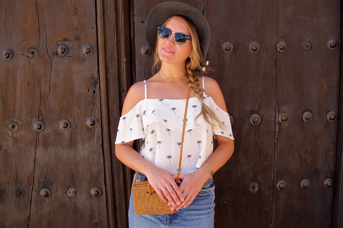 Too Many Doors. Fashion Blogger Girl by Style Blog Heartfelt Hunt. Girl with blond braid wearing a white off-shoulder top, denim skirt, straw hat, Ray-Ban sunglasses, straw bag and Birkenstock sandals.
