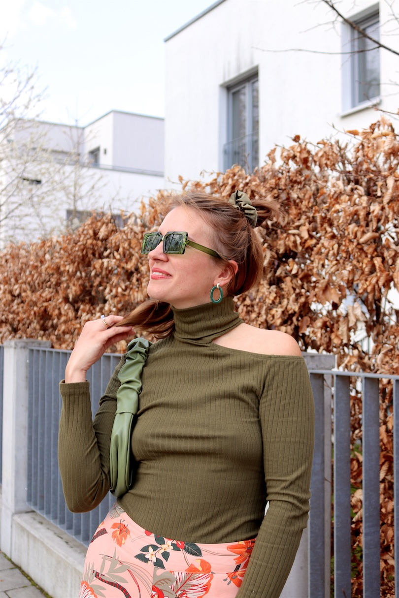 Tropical Pants. Fashion Blogger Girl by Style Blog Heartfelt Hunt. Girl with blond half-up and half-down hairstyle with green scrunchie wearing tropical pants, cut out top, green sunglasses, green ruched bag, orange socks and orange heels.