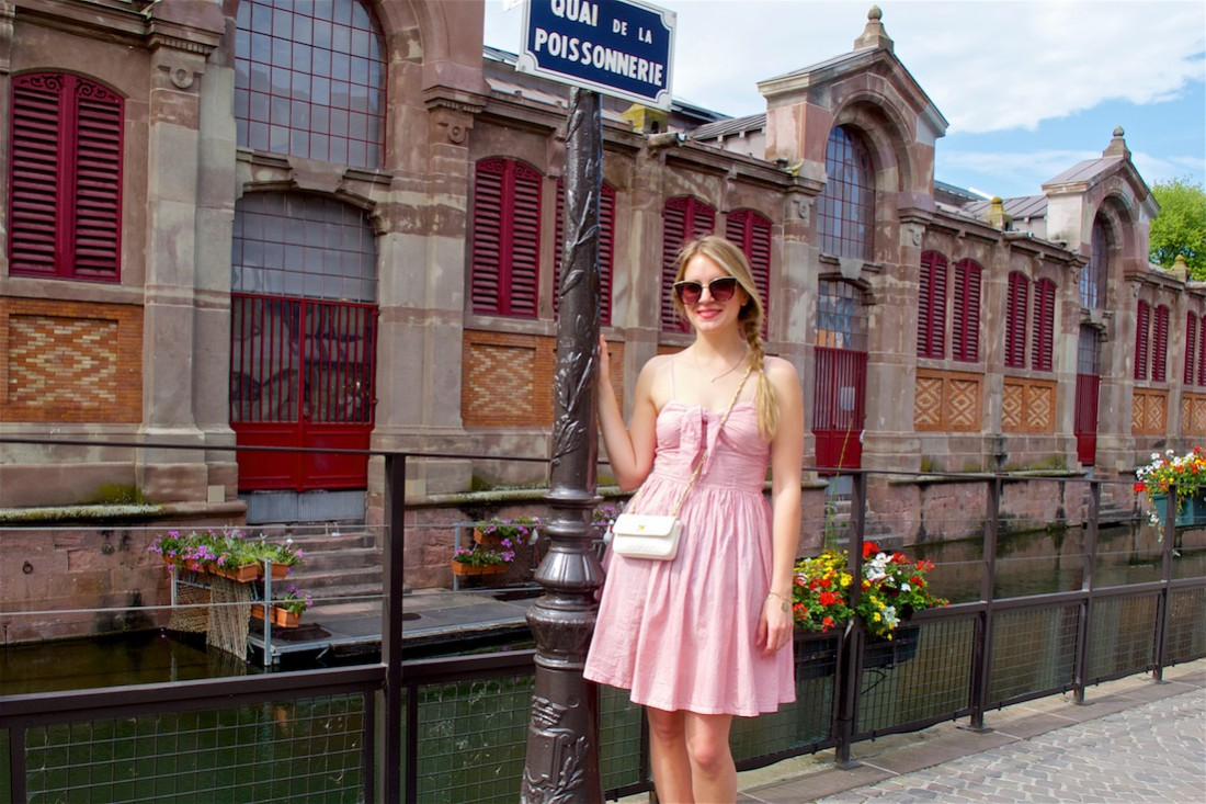 Welcome to Colmar. Fashion Blogger Girl by Style Blog Heartfelt Hunt. Girl with a side braid wearing an A-line dress, sunglasses and a Chanel bag.