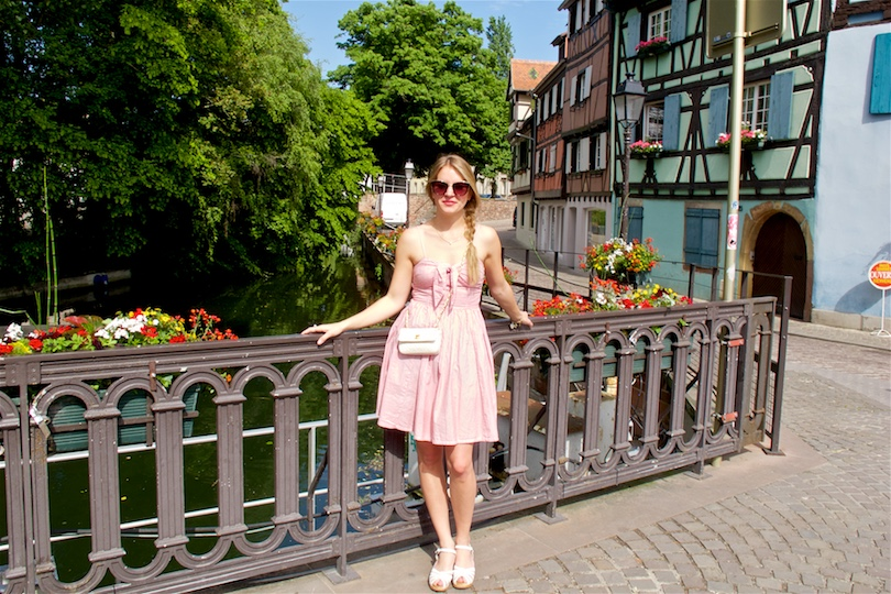 Welcome to Colmar. Fashion and Style Blog Girl from Heartfelt Hunt. Girl with a side braid wearing an A-line dress, sunglasses, Chanel bag and Swedish Hasbeens.