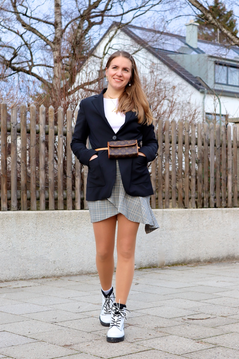 White Boots. Fashion Blogger Girl by Style Blog Heartfelt Hunt. Girl with blond hair and bobby pins wearing white boots, long blazer, white top, checked skirt with ruffles, Louis Vuitton belt bag and earrings.