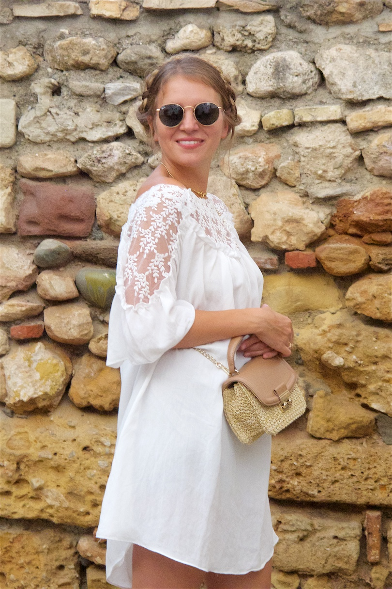 White Lace. Fashion and Style Blog Girl from Heartfelt Hunt. Girl with blonde halo braid wearing a white lace dress, Ray-Ban sunglasses, straw bag and studded sandals.