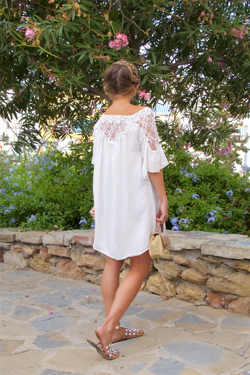 White Lace. Fashion Blogger Girl by Style Blog Heartfelt Hunt. Girl with blond halo braid wearing a white lace dress, Ray-Ban sunglasses, straw bag and studded sandals.