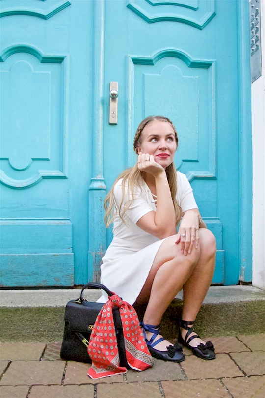 White Lace Up Dress. Fashion Blogger Girl by Style Blog Heartfelt Hunt. Girl with blond braided half-up half-down hairstyle wearing a white lace up dress, red vintage scarf, vintage MCM bag and lace up ballet flats.