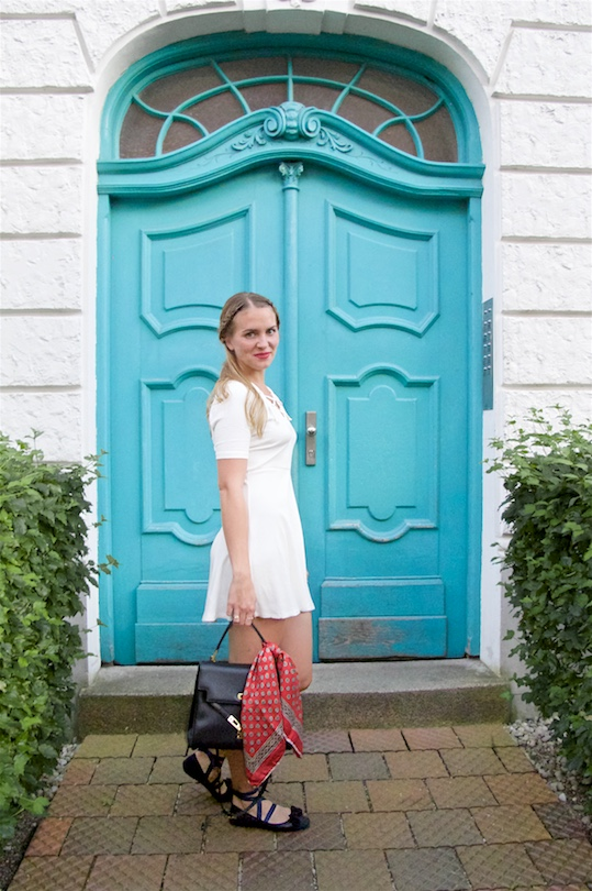 White Lace Up Dress. Fashion and Style Blog Girl from Heartfelt Hunt. Girl with blonde braided half-up half-down hairstyle wearing a white lace up dress, red vintage scarf, vintage MCM bag and lace up ballet flats.