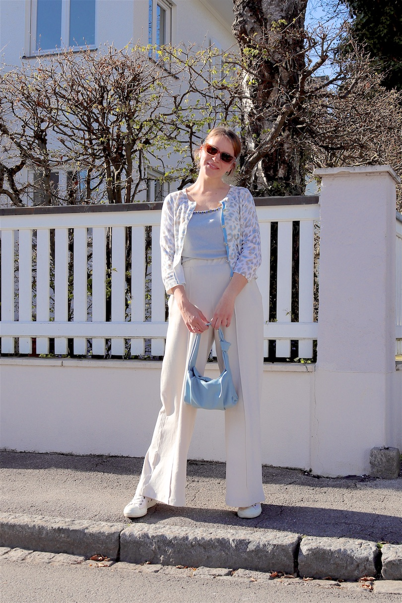 Wide Leg Pants. Fashion and Style Blog Girl from Heartfelt Hunt. Girl with blonde low bun and light blue hair clips wearing wide leg pants, blue cardigan, clue knitted top, slim sunglasses, light blue bag and white Converse chucks.