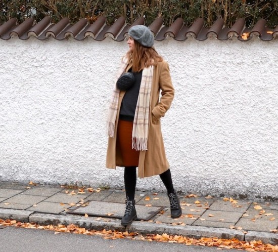 Winter Layering. Fashion Blogger Girl by Style Blog Heartfelt Hunt. Girl with blond hair wearing a camel coat, turtleneck sweater, knit dress, beret, checked scarf, belt bag and Timberland boots.