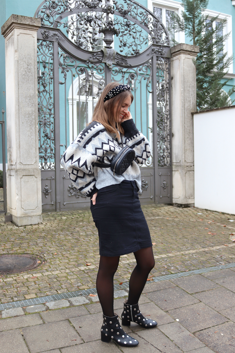 Winter Pearls & Studs. Fashion and Style Blog Girl from Heartfelt Hunt. Girl with blonde hair and a headband with pearls wearing a Norwegian sweater, black denim skirt, belt bag and boots with studs.