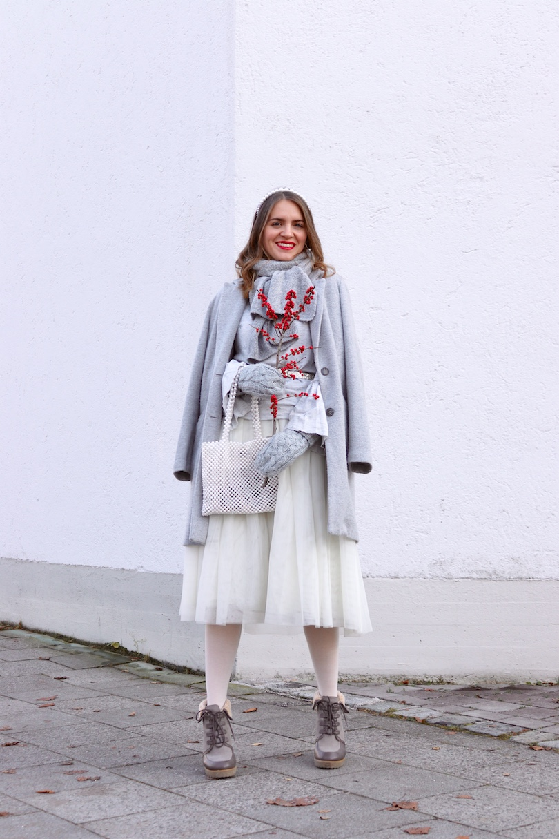 Winter Whites. Fashion Blogger Girl by Style Blog Heartfelt Hunt. Girl with blond, loose curls wearing a coat, sweater with trumpet sleeves, tulle skirt, pearl headband, pearl bag, mittens and faux fur booties.
