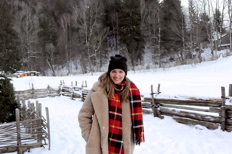 Winter Wonderland. Fashion Blogger Girl by Style Blog Heartfelt Hunt. Girl with blond hair wearing a teddy coat, red sweater, mom jeans, red plaid scarf, beanie with pompom, Rebecca Minkoff backpack and Sorel boots.