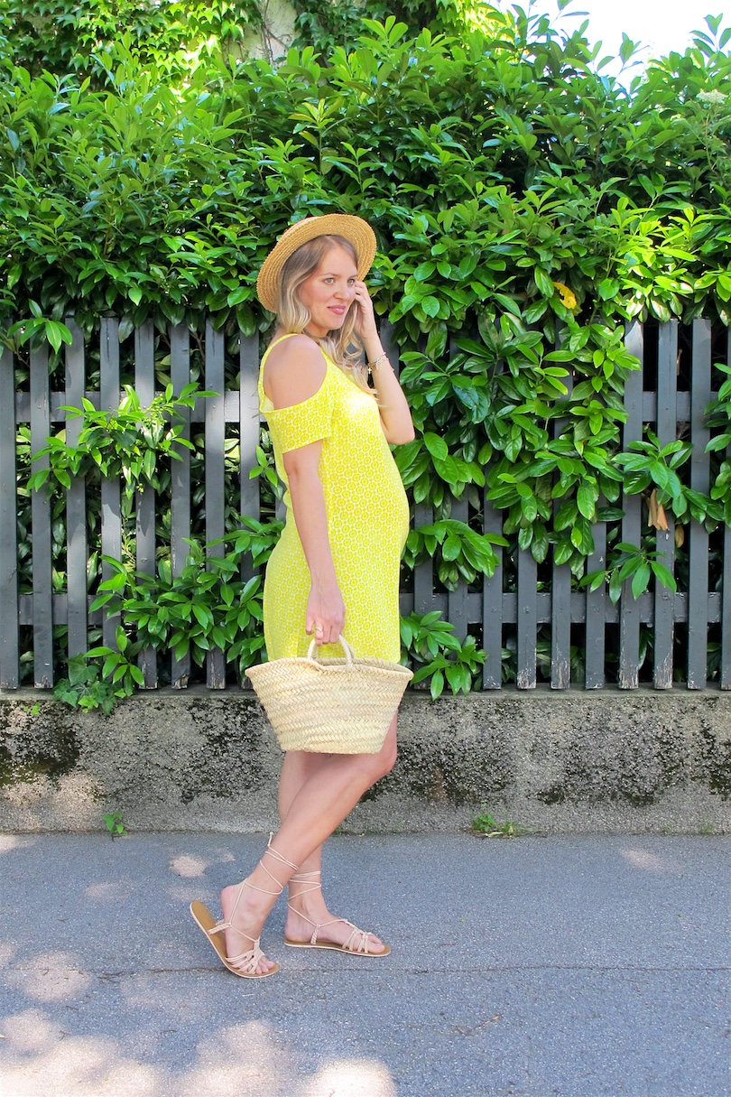 Yellow Cold Shoulder Dress. Fashion and Style Blog Girl from Heartfelt Hunt. Girl with blonde, loose curls wearing a yellow cold shoulder dress, straw hat, basket bag and lace up sandals.