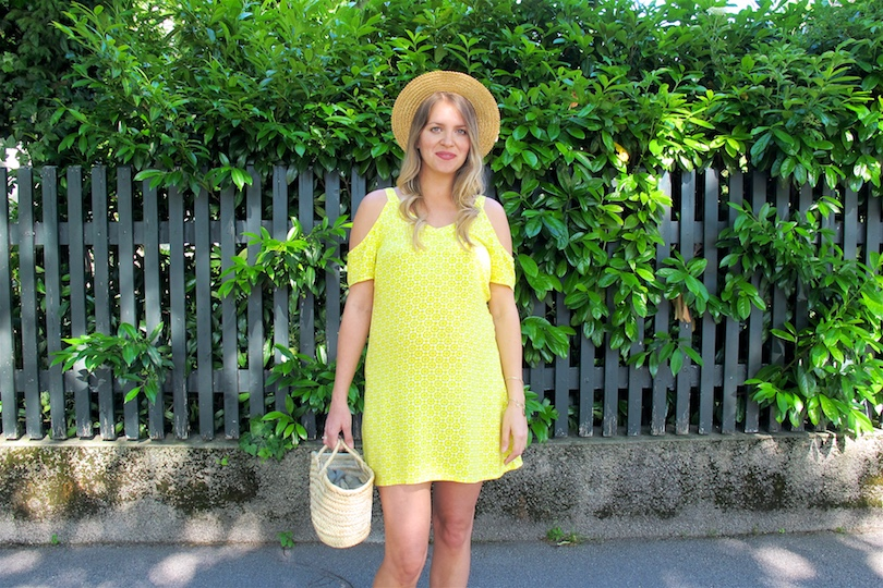 Yellow Cold Shoulder Dress. Fashion Blogger Girl by Style Blog Heartfelt Hunt. Girl with blond, loose curls wearing a yellow cold shoulder dress, straw hat, basket bag and lace up sandals.