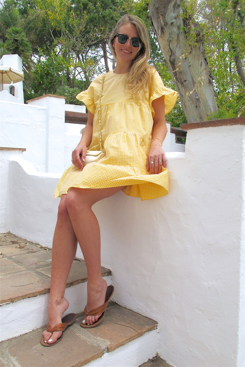 Yellow Gingham. Fashion and Style Blog Girl from Heartfelt Hunt. Girl with blonde, long hair wearing a yellow gingham dress, vintage Chanel bag, Ray-Ban sunglasses and sandals.