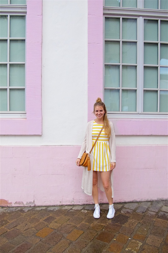 Yellow Striped Dress. Fashion and Style Blog Girl from Heartfelt Hunt. Girl with half-up half-down knot hairstyle wearing a yellow striped dress, long cardigan, tassel bag and Converse Chucks.
