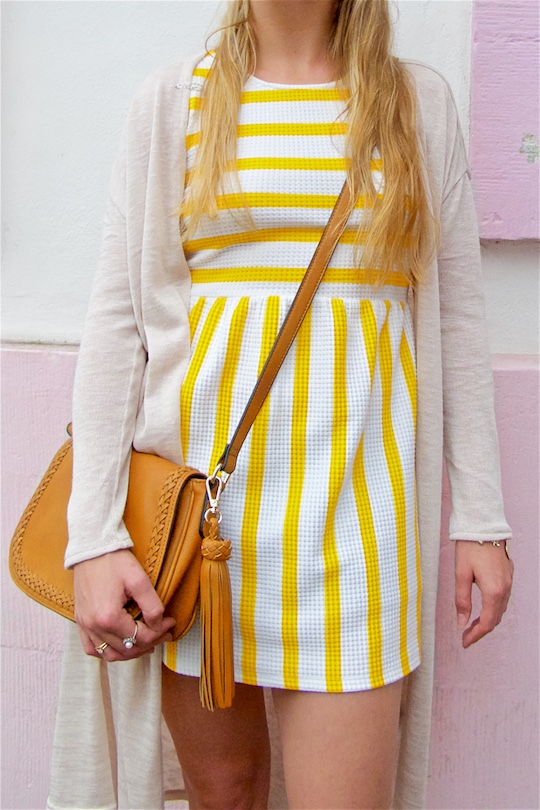 Yellow Striped Dress. Fashion Blogger Girl by Style Blog Heartfelt Hunt. Girl with half-up half-down knot hairstyle wearing a yellow striped dress, long cardigan, tassel bag and Converse Chucks.