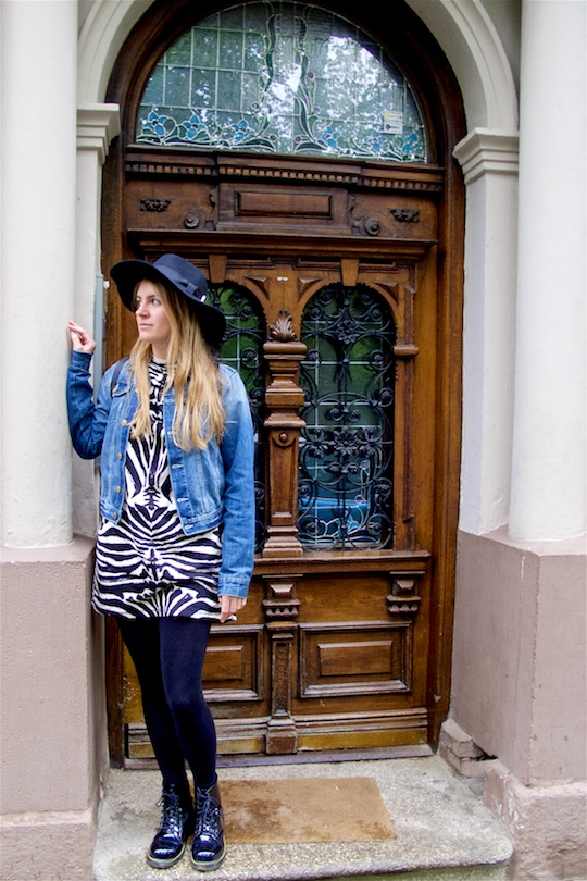 Zebra Dress. Fashion Blogger Girl by Style Blog Heartfelt Hunt. Girl wearing a zebra dress, denim jacket, backpack, floppy hat and glossy boots.