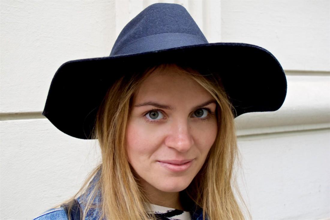 Zebra Dress. Fashion Blogger Girl by Style Blog Heartfelt Hunt. Girl wearing a zebra dress, denim jacket, backpack and floppy hat.